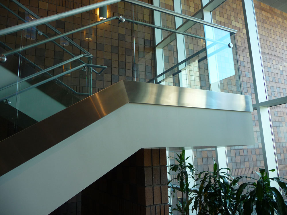 Midwestern University. Stainless steel cladding at base of glass guardrail.