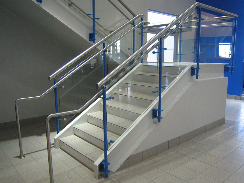 Santan Honda. Painted steel, glass, and stainless handrail.