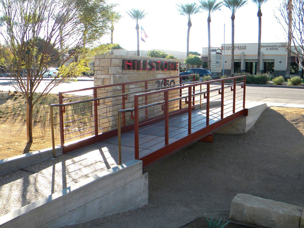 Hillstone Restaurant. Steel painted railing with stainless steel cables and handrail.