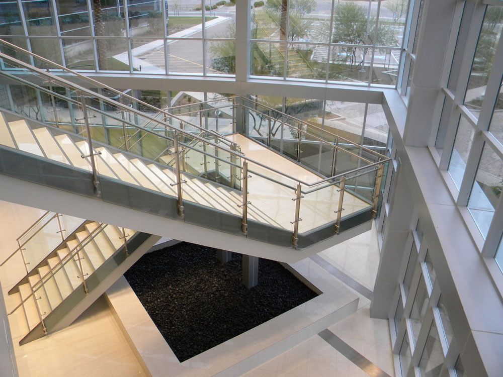 Continium - glass with stainless steel post, cap rail and handrail.