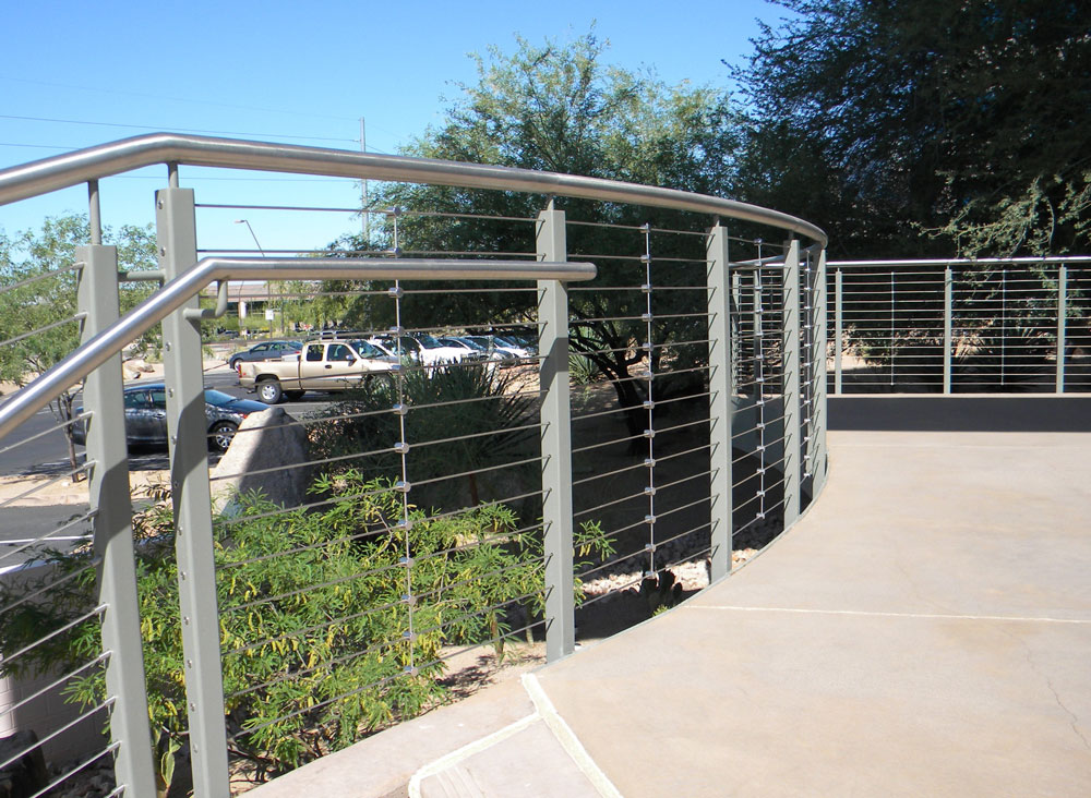 Southland - Stainless steel cables and handrail with painted steel post.