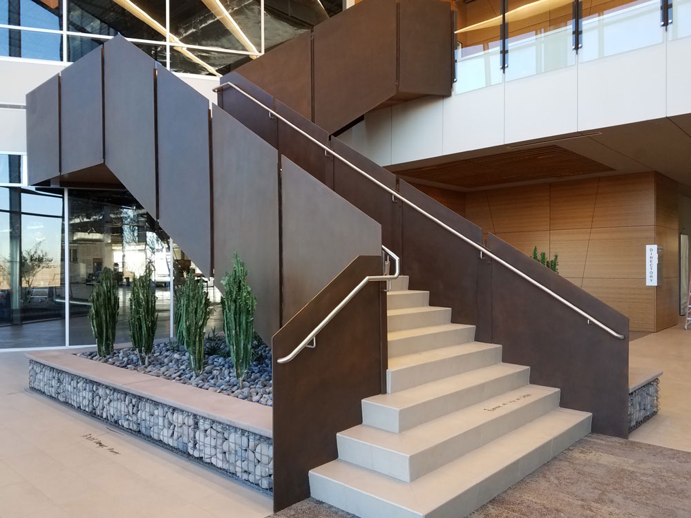 Liberty Three. Steel panels with custom finish, stainless Handrail.