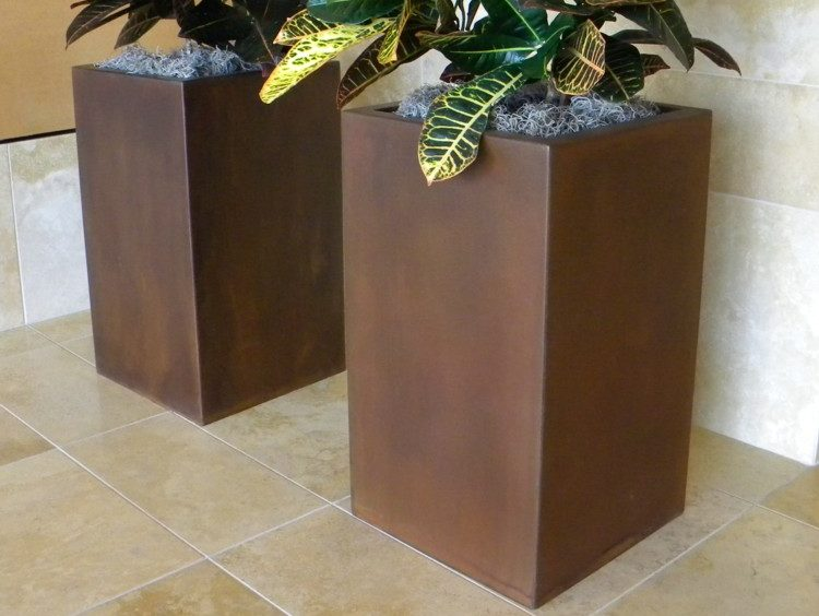 Allred. Steel planters with custom finish.