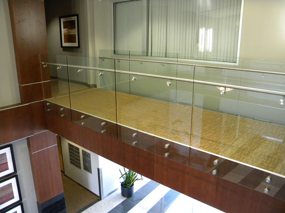Southbank Corporate Center - Glass with stainless steel puck system and handrail.