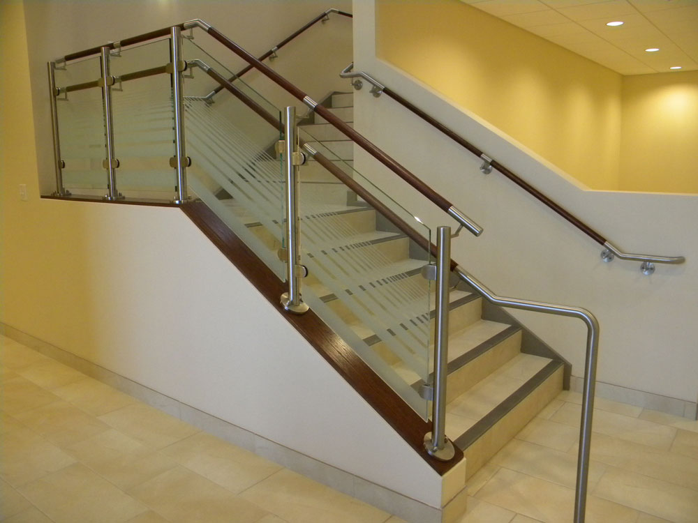 St. Bernards Parish - glass with stainless steel post. Stainless steel and wood handrail.
