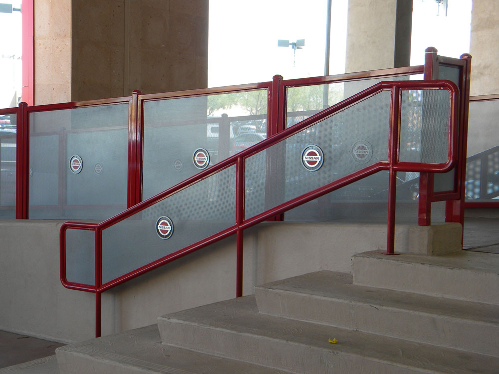 Pinnacle Nissan - stainless steel perf metal with custom logo in painted steel railing.