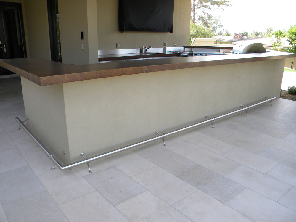 Private residence. Stainless steel two leg support.