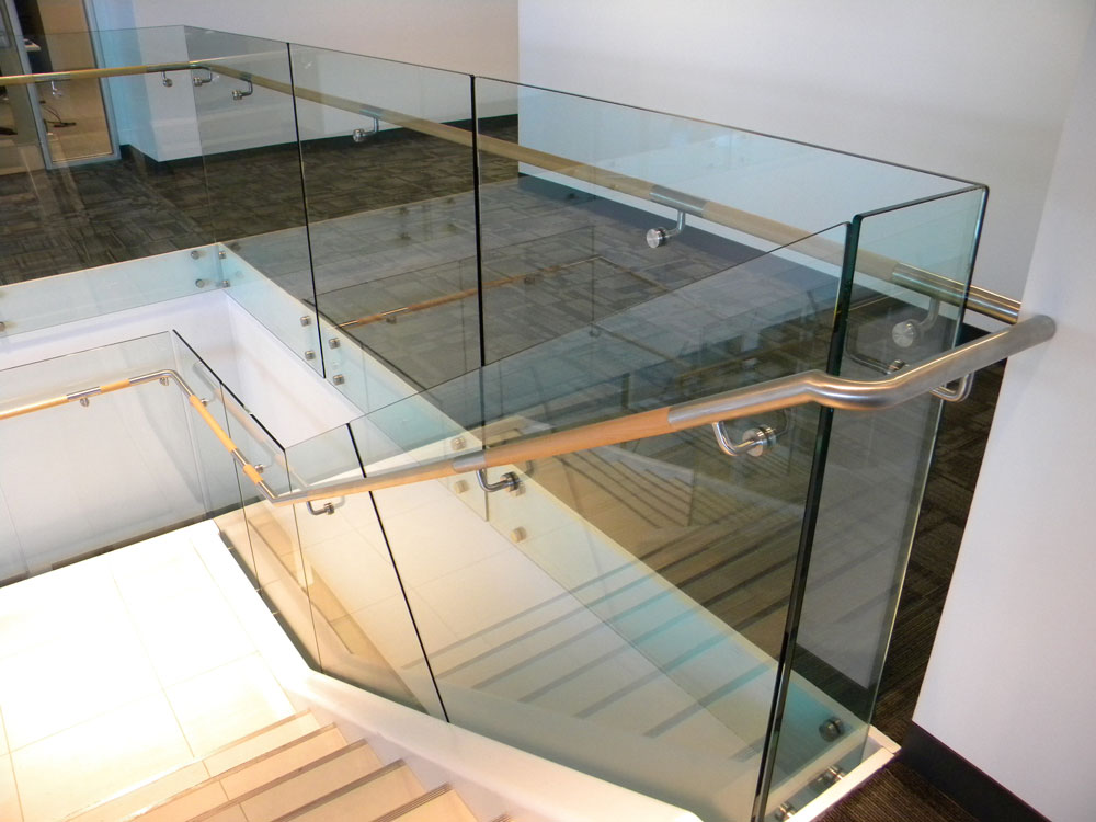 QBE - glass with stainless steel puck system. Stainless steel and wood handrail.