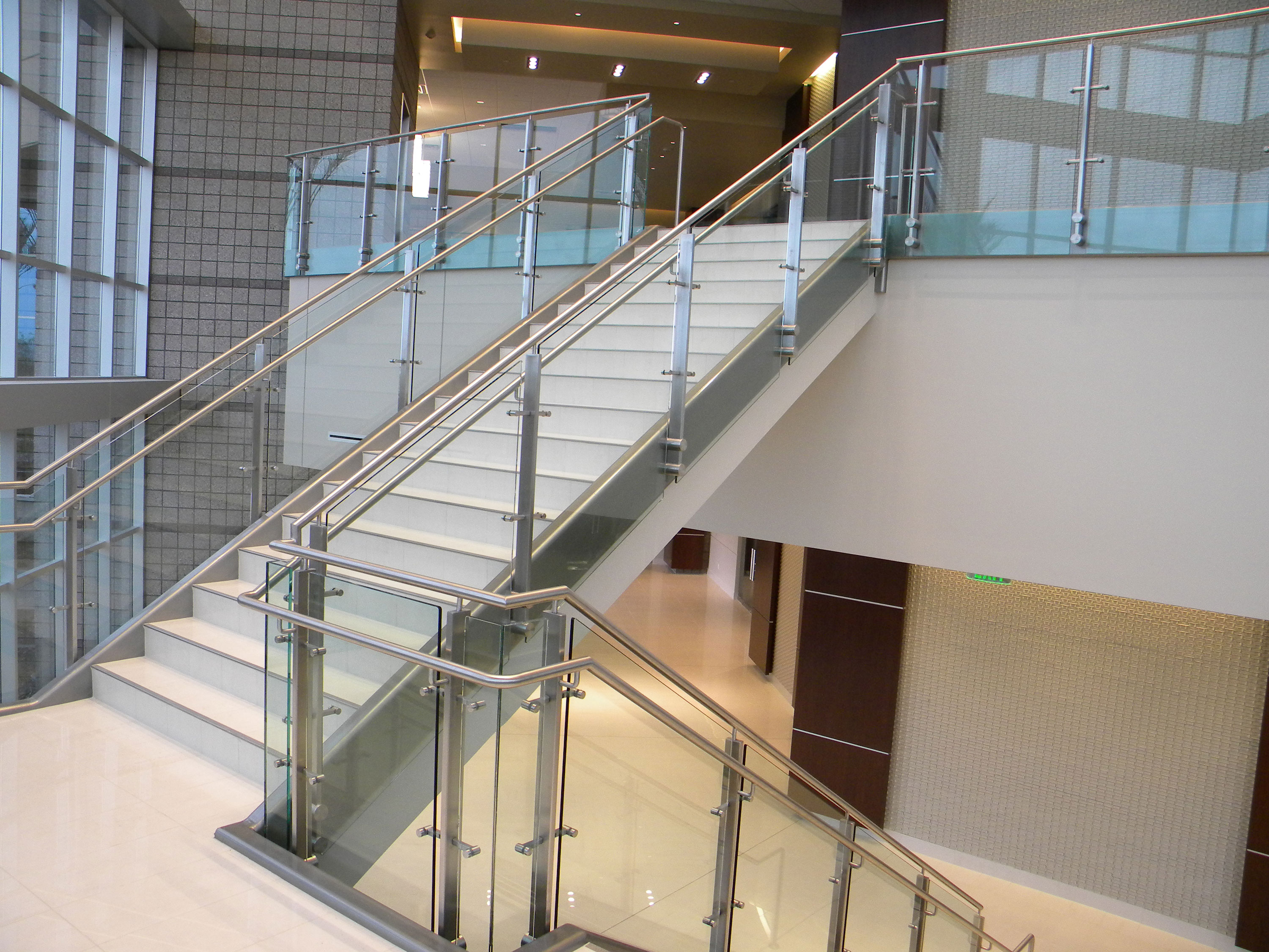 Continuim - glass with stainless steel post, cap rail and handrail.