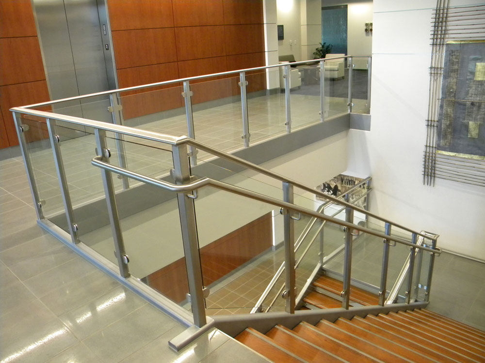 Amkor - glass with stainless steel post, cap rail and handrail.