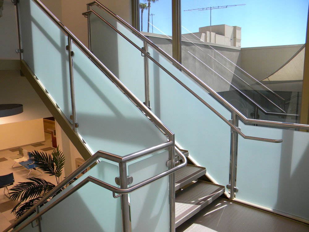 TASC - frosted glass with stainless steel post, cap rail and handrail.