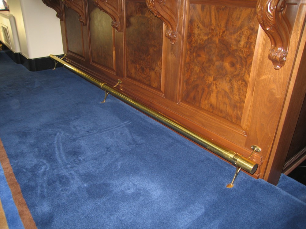 Private residence. Brass with two leg support.