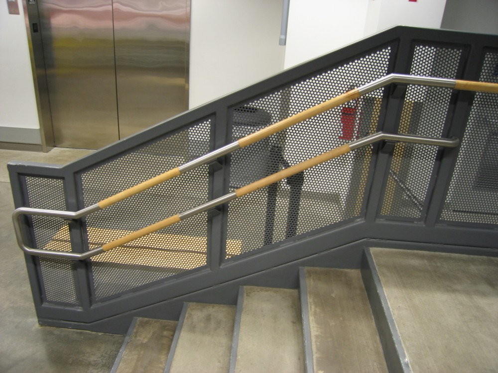 IKEA - painted steel post and perf metal. Stainless steel and wood handrail.