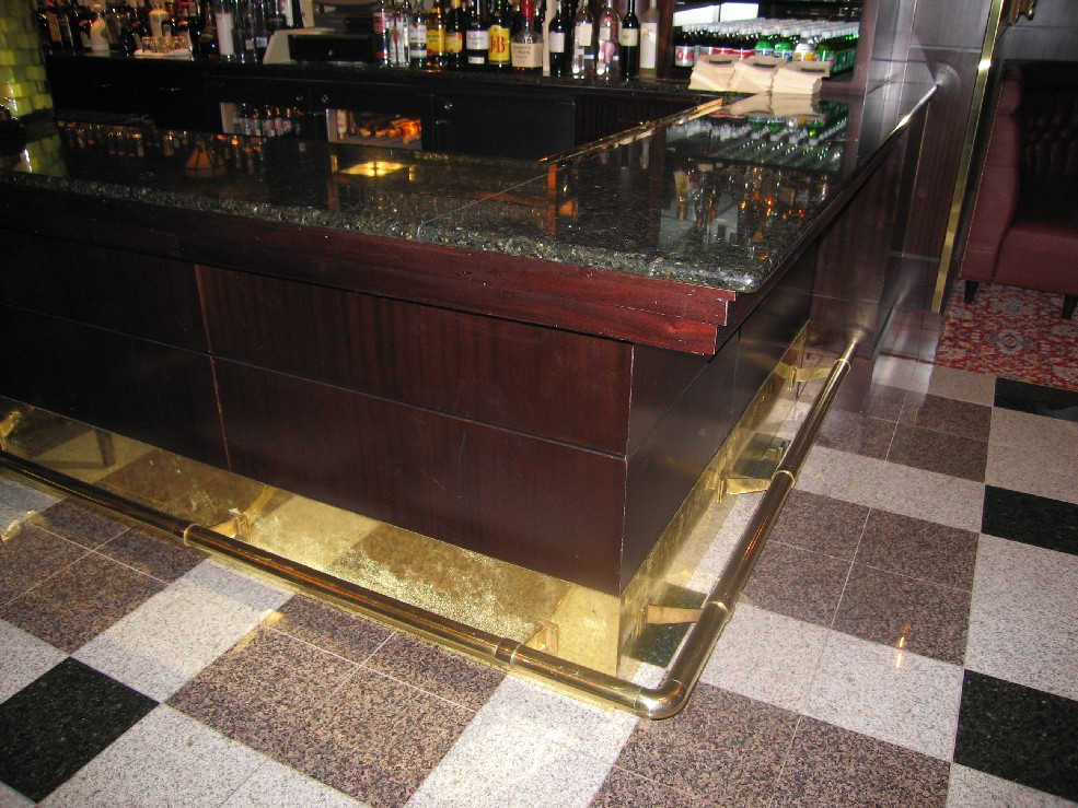 Capitol Grill. Brass wall support with kick plate.