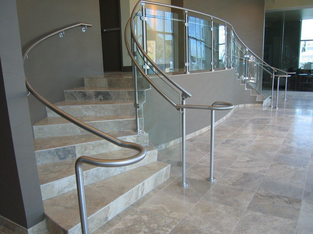 Edgewater - radius glass with stainless steel post and handrail.