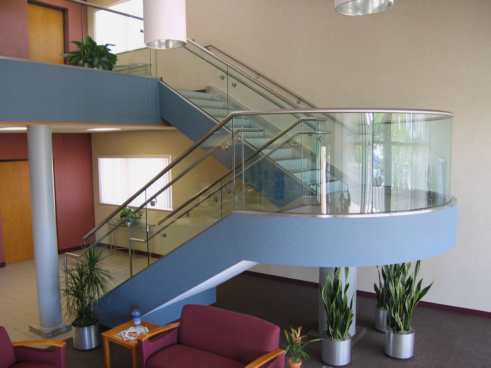 Chandler Water Treatment Center - Radius glass and shoe with stainless steel handrail and cap rail.