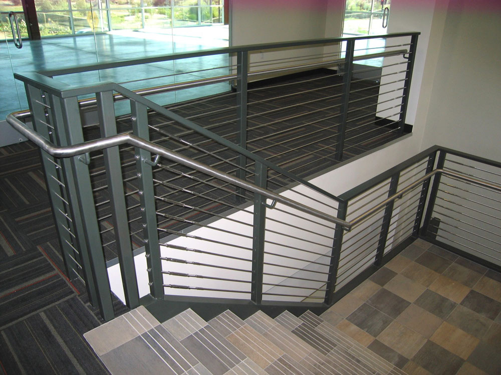 Irgens - Stainless steel cable and handrail on painted steel post.