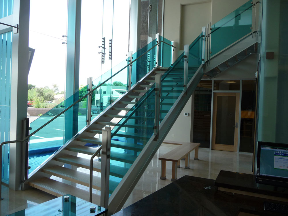 Clayton National Headquarters - tinted glass with stainless steel post and handrail.