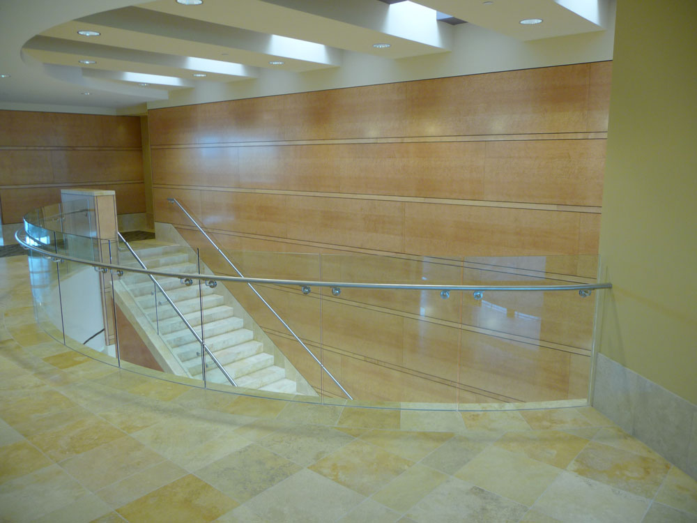 Allred Park Place - Radius glass in custom shoe with Stainless steel handrail.