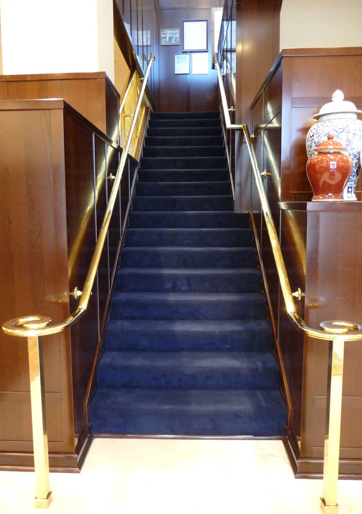 Brooks Brothers - polished brass handrail.