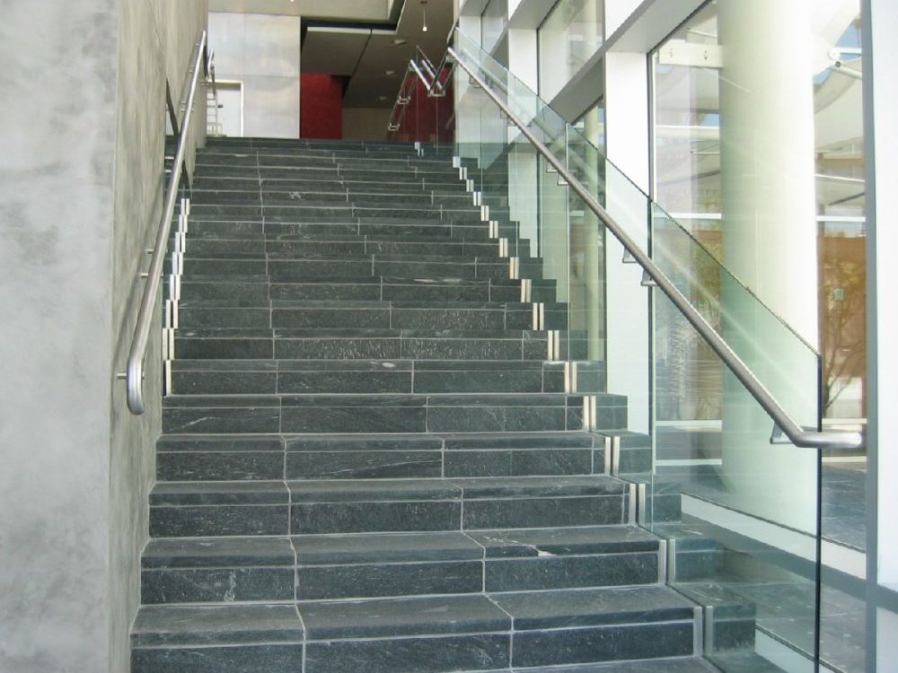 Mesa Arts Center - Glass in shoe with stainless steel handrail and trim.