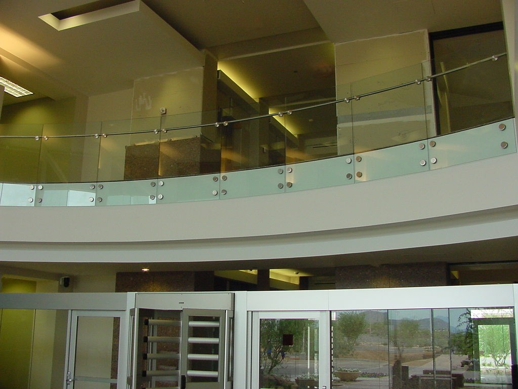 USAA - Segmented glass with stainless steel puck system and handrail.