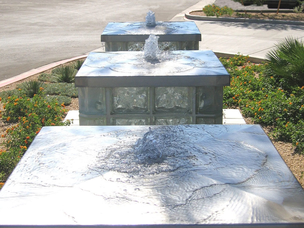 Commercial water features. Stainless steel caps.
