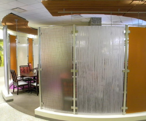 Sagewood. Stainless steel and plastic room divider.