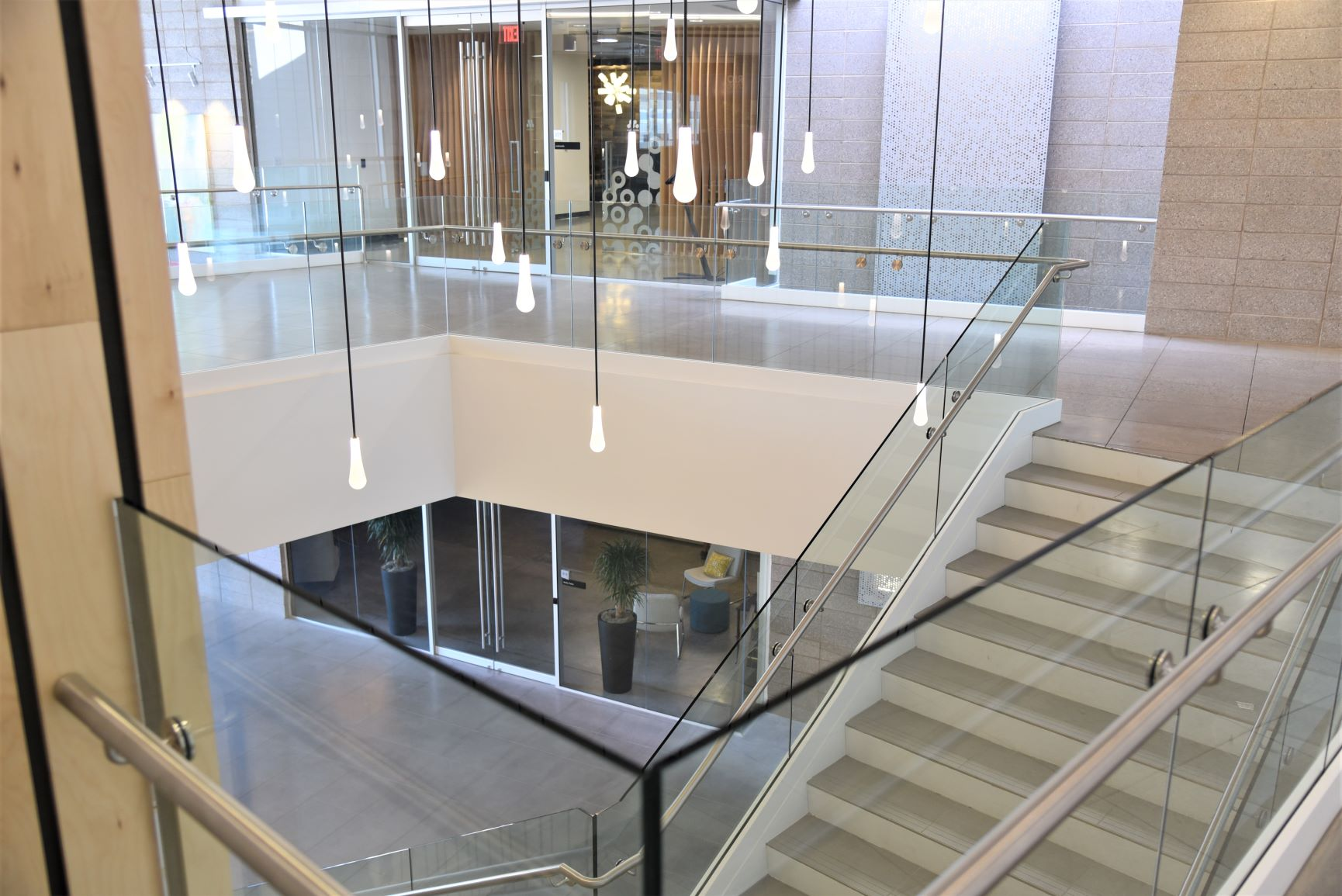 Scope: Stainless steel glass railings with painted steel base cladding.