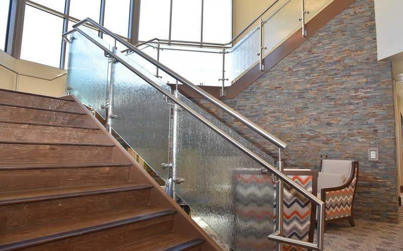 Scope: Stainless Steel posts with rain glass infills. Contractor: The Weitz Company Architect: Todd & Associates Inc.
