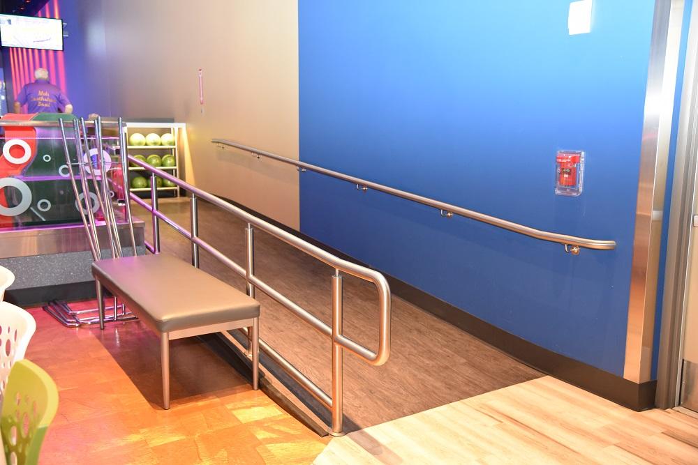 Scope: Custom Illuminated bar rack and illuminated glass guardrails. Contractor: A. R. Mays